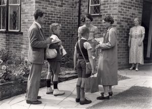 Evacuees being introduced to a prospective family in Brighton