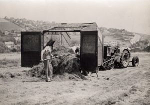 Women's Land Army loading or emptying a tractor trailer