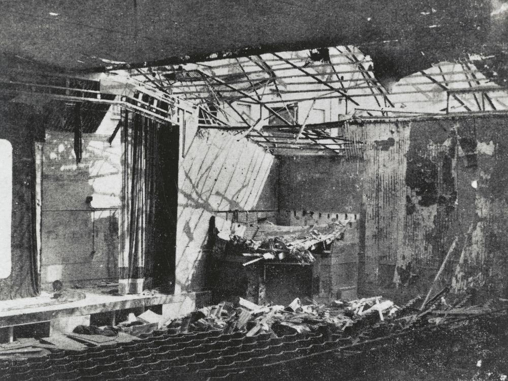 Scene of bombed interior of a cinema. collapsed roof and debris on the floor.