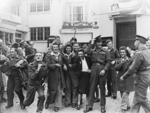 Celebrating Victory over Japan (VJ) day in East Street, Brighton, 18 August 1945