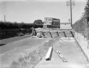 A bus negotiating a roadblock, 15 June 1940