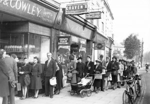People queuing for bread outside Cowley's Bakery Dyke Road during the Second World War.